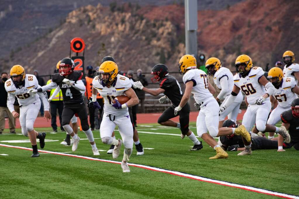 Basalt High School's running back Gavin Webb breaks into the secondary during the game at Aspen High School on Friday, April 16, 2021. (Kelsey Brunner/The Aspen Times)
