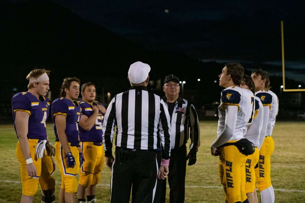 Team captains from Basalt and Rifle watch the coin flip before the game at the Longhorns' stadium on Friday, Oct. 22, 2021. | Kelsey Brunner/The Aspen Times
