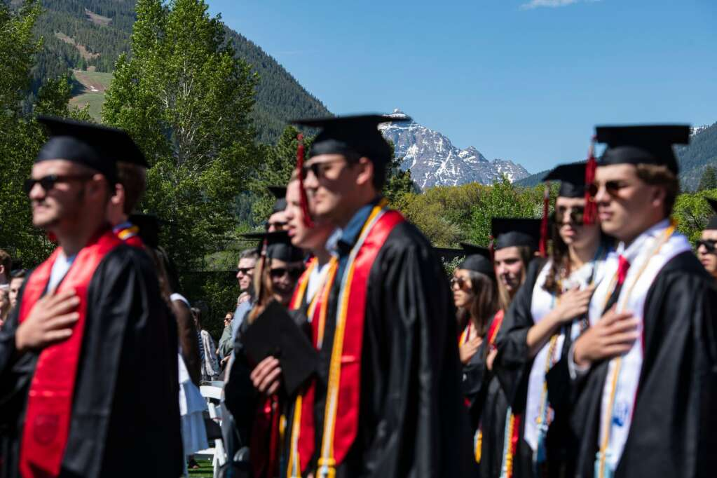 Aspen High School graduates stand for the Pledge of Allegiance in view of Capitol Peak on Saturday, June 5, 2021. (Kelsey Brunner/The Aspen Times)