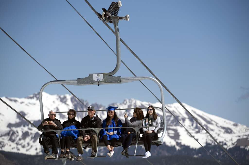 Ren Bittner, a graduating senior of The Peak School, rides up the Super Bee chairlift with family members Thursday, May 27, at Copper Mountain Resort to receive her diploma.   Photo by Jason Connolly /Jason Connolly Photography