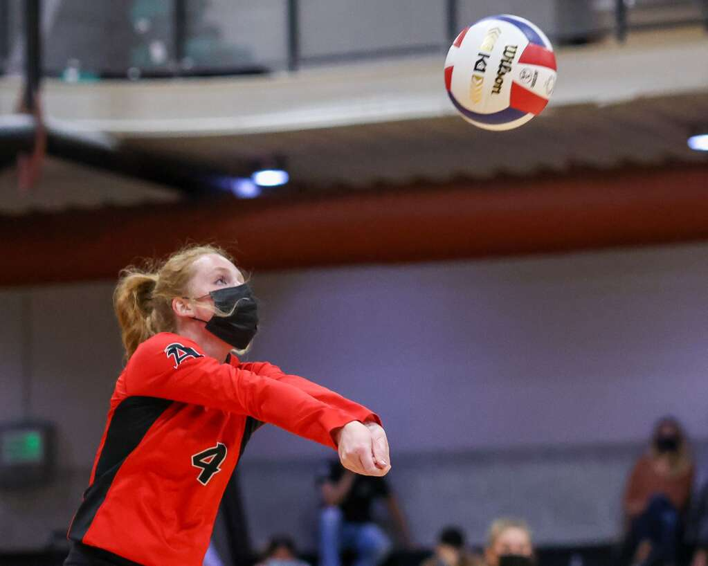Aspen High School's Reese Leonard looks to return a serve as the AHS volleyball team hosts Glenwood Springs on Thursday, Aug. 19, 2021, inside the AHS gymnasium. The Skiers won, 3-2. Photo by Austin Colbert/The Aspen Times.