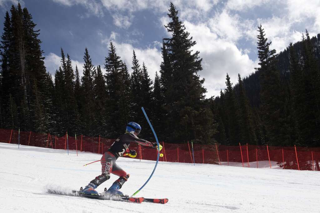 Battle Mountain High School Alpine team skier Alexander Armistead skis past a gate while racing the slalom course during the Colorado High School State Alpine Ski Championships at Loveland Valley Ski Area on Thursday, March 11, 2021. | Photo by Jason Connolly / Jason Connolly Photography
