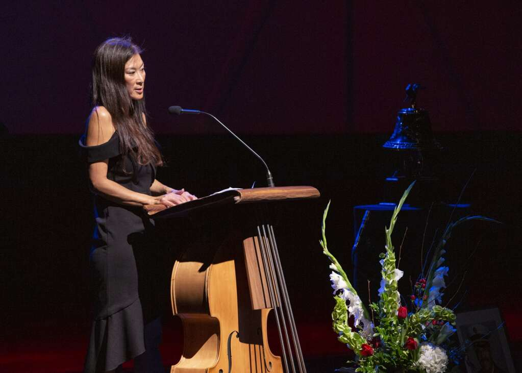 Kelly Trang speaks to an audience of hundreds of people honoring her late fiancée Paul Hewitt during a memorial service Thursday. | (Tanzi Propst/Park Record)