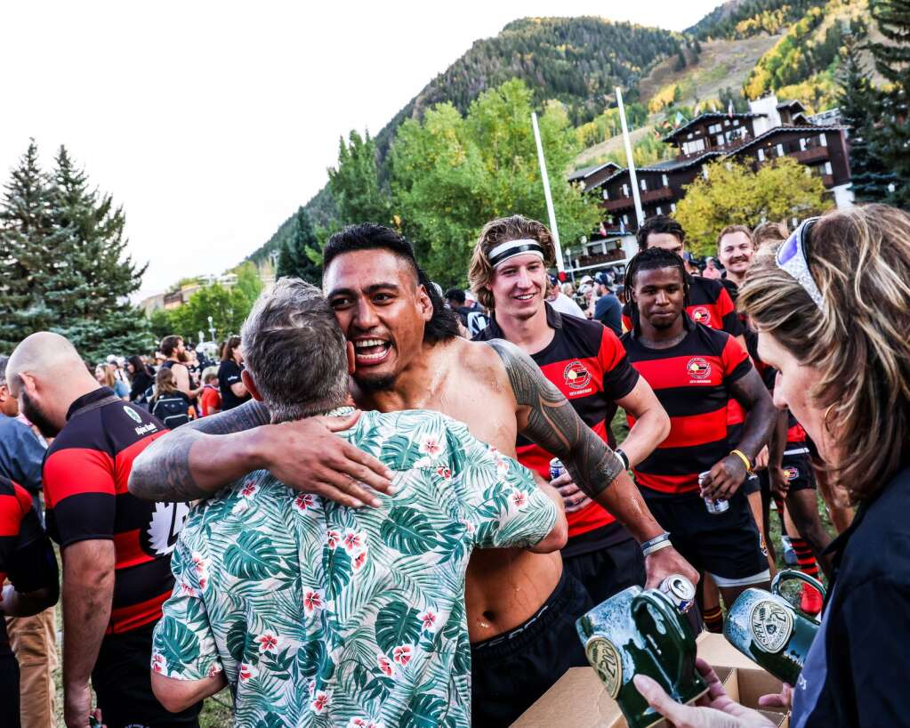 Coach and new Aspen rugby hall of fame member Cameron McIntyre gets a hug while handing out the winning mugs after the Gentlemen of Aspen Rugby Club beat the American Raptors to win Ruggerfest 53 on Sunday, Sept. 26, 2021, on Wagner Park in downtown Aspen. Photo by Austin Colbert/The Aspen Times.