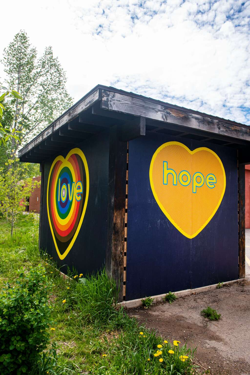 Artist Koko Bayer's work is displayed next to the bike path outside of the Red Brick Center for the Arts in Aspen on Wednesday, June 2, 2021. (Kelsey Brunner/The Aspen Times)