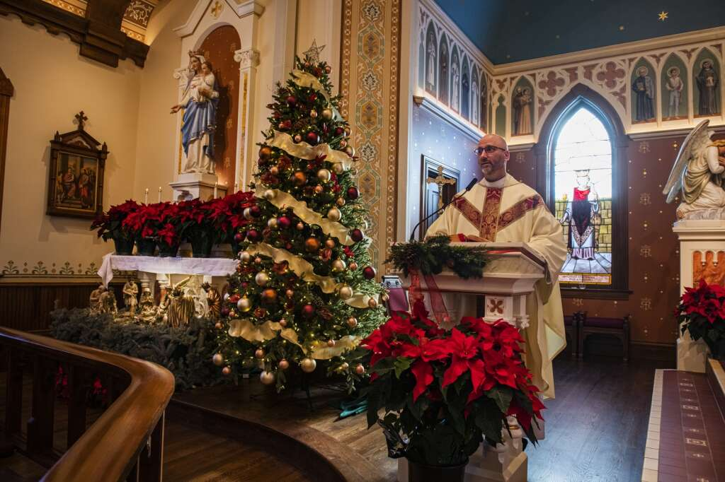 Rev. Darrick Leier stands at the pulpit before a Christmas Eve mass in St. Mary Catholic Church in Aspen on Dec. 24, 2020. (Kelsey Brunner/The Aspen Times)