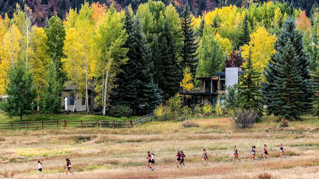 Runners compete in the varsity girls high school cross country race of the Chris Severy Invitational on Saturday, Oct. 9, 2021, near Aspen High School. Photo by Austin Colbert/The Aspen Times.