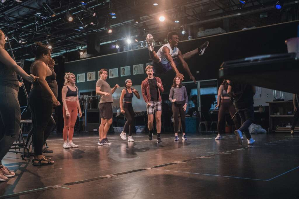 Kalonjee Gallimore catches big air in front of the cast of Theatre Aspen's
