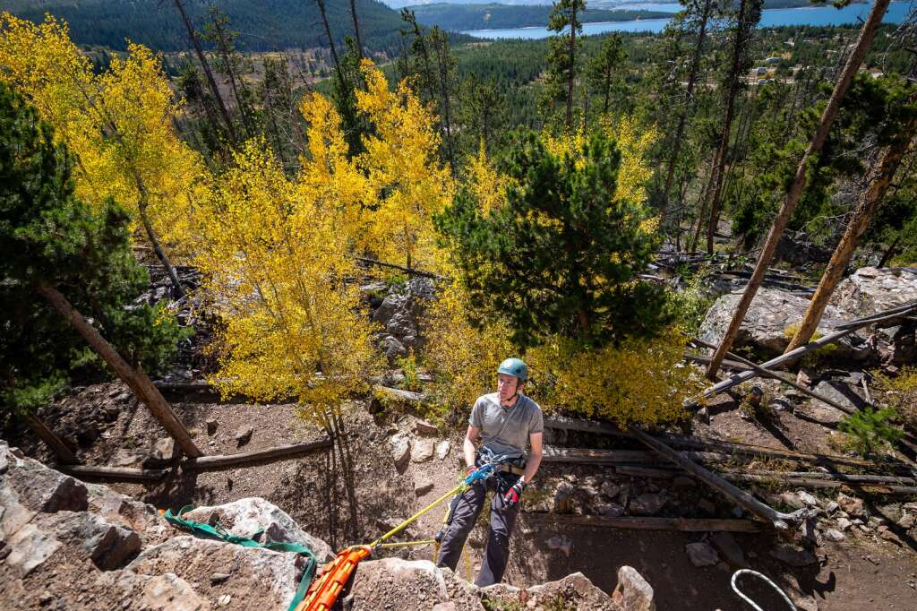 Martin Barnett demonstrates the basics of rock climbing safety during a search and rescue training course on Friday, September 24, near Windy Point Campground.  |  Liz Copan / For the Daily News Summit