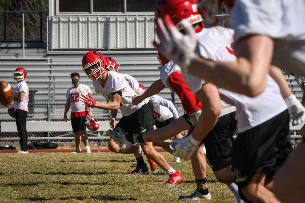 The Glenwood Springs High School Demon football team run through drills and plays during Thursday afternoon's practice. |Chelsea Self / Post Independent