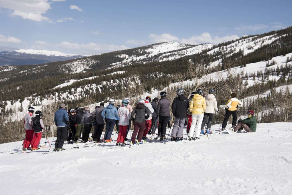 Skiers meet at the top of Banzai Ridge at Snowmass for a memorial to honor the life of longtime local Steve Wiggins on Sunday, April 25, 2021. | Mark Borderick/Courtesy photo