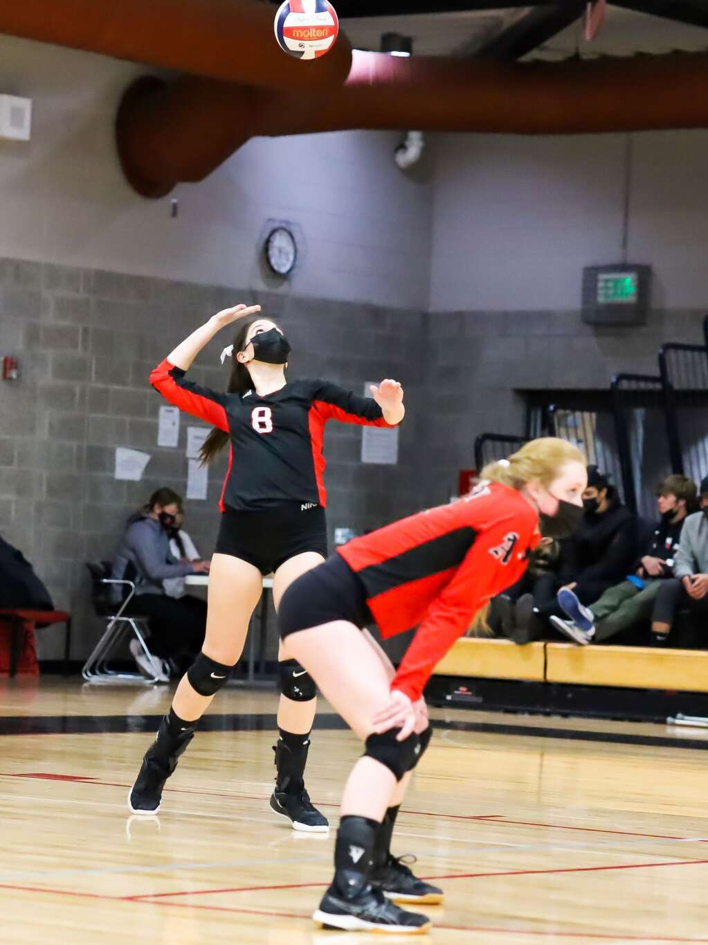 Aspen High School volleyball's Sofie Durham serves against Gunnison on Saturday, April 17, 2021, inside the AHS gymnasium. Gunnison won, 3-1. Photo by Austin Colbert/The Aspen Times.