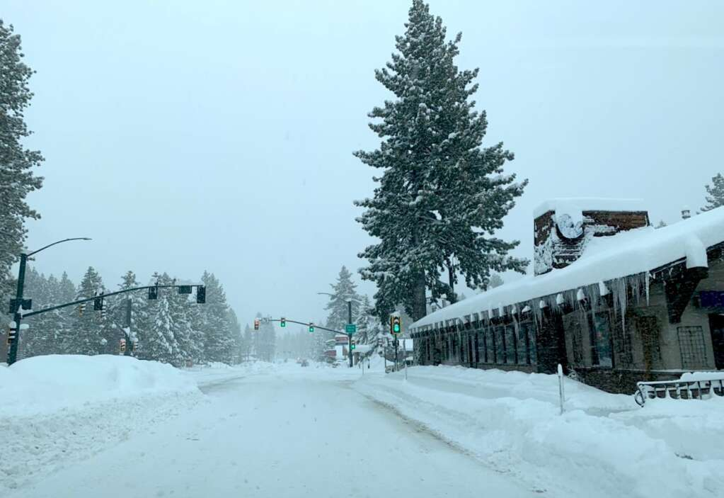 Snow is piled high in South Lake Tahoe. <em id=