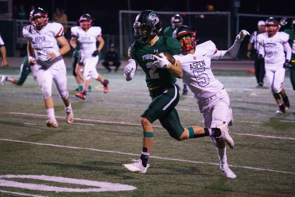 Summit Tigers senior wide receiver Philip Berezinski sheds a tackle after a completion in the third quarter of the Tigers 37-20 win over the Aspen Skiers Friday, Sept. 10, at Tiger Stadium in Breckenridge. | John Hanson/For the Summit Daily News