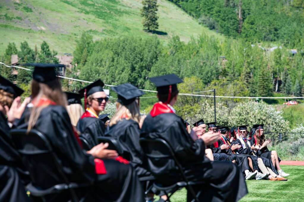Aspen High School graduates sit on the turn field during the commencement ceremony on Saturday, June 5, 2021. (Kelsey Brunner/The Aspen Times)