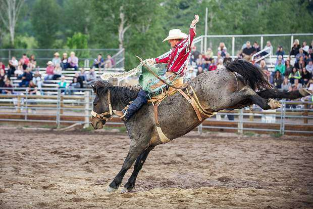 Garrett Buckley participates in the bronc riding competition at the Snowmass Rodeo in 2017. | Anna Stonehouse/Snowmass Sun file photo