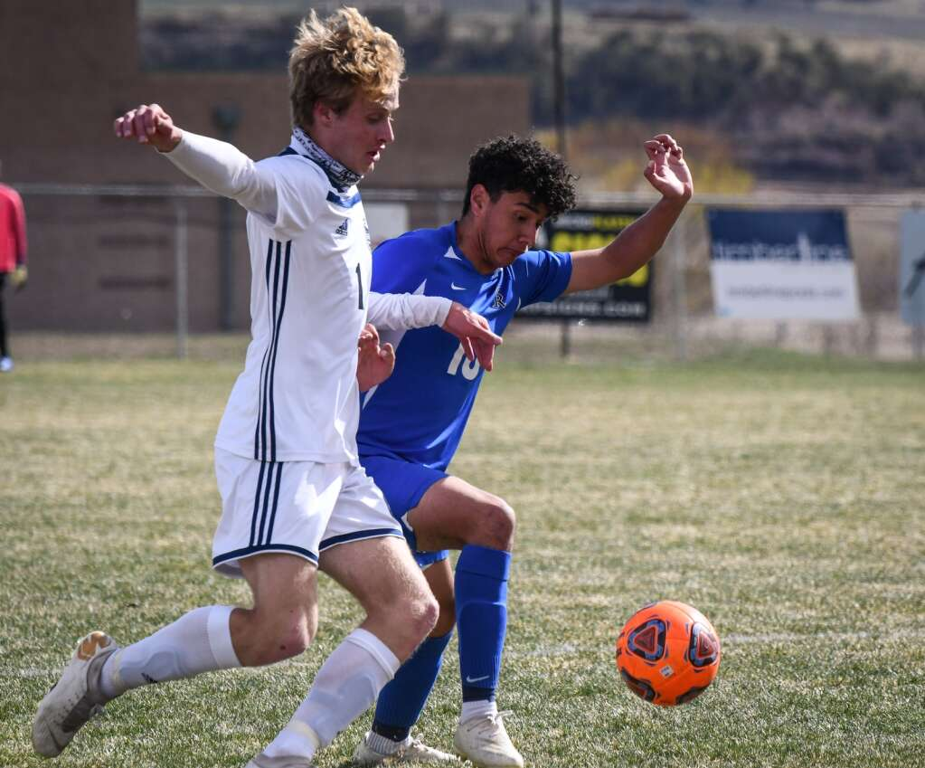 Coal Ridge Titan Moises Contreras fights to gain possession of the ball during Tuesday afternoon's game against the Vail Mountain Gore Rangers. |Chelsea Self / Post Independent