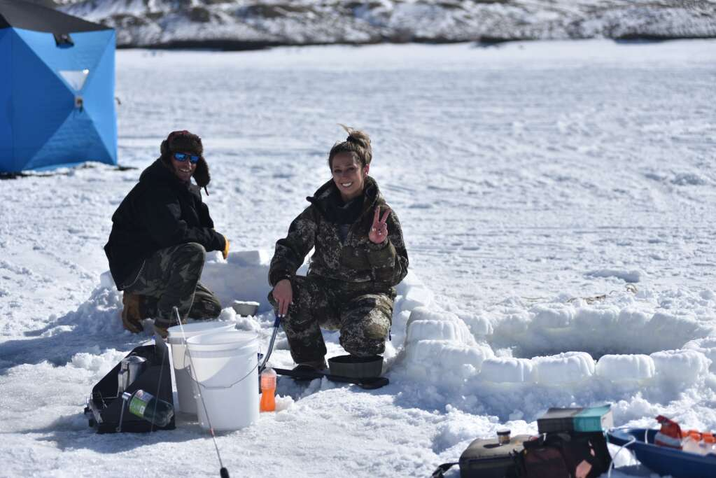 A couple folks build an igloo Saturday at the Wolford Ice Fishing Tournament. | Amy Golden / agolden@skyhinews.com