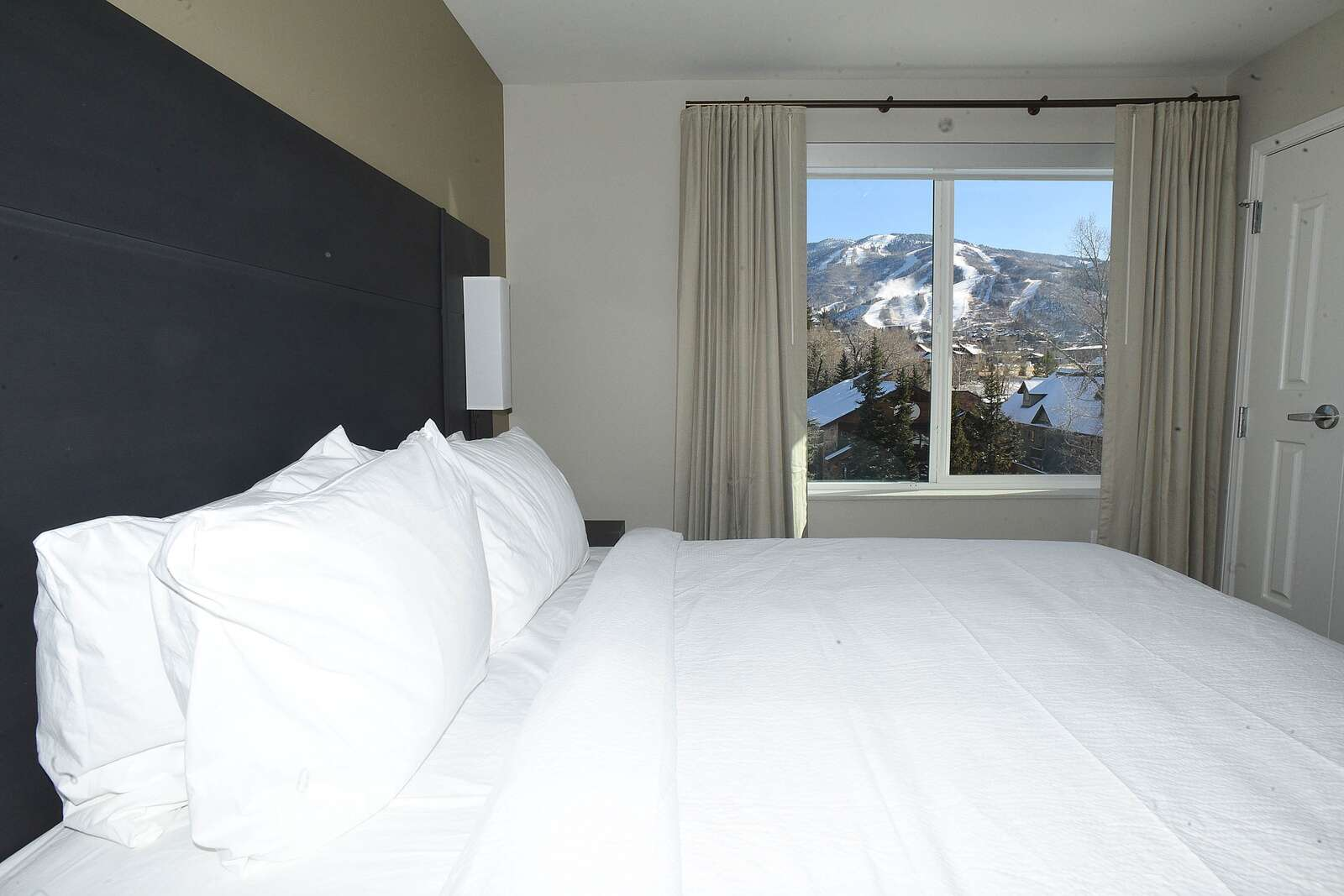 This one-bedroom suite at the new Residence Inn by Marriott offers a king bed, and view of Mount Werner and the nearby slopes of the Steamboat Resort. (Photo by John F. Russell)