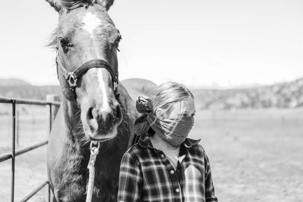 Leila Devins, daughter of Executive Director Shana Devins, helps out at the Mountain Valley Horse Rescue May 2020 in McCoy.