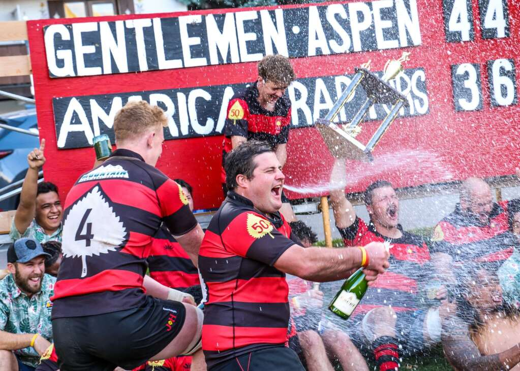 The Gentlemen of Aspen Rugby Club's Darren Barth, center, celebrates with champagne after the Gents beat the American Raptors to win Ruggerfest 53 on Sunday, Sept. 26, 2021, on Wagner Park in downtown Aspen. Photo by Austin Colbert/The Aspen Times.