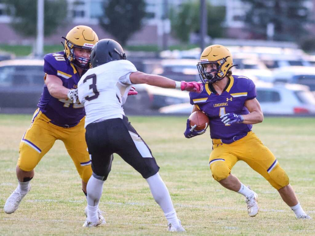 Basalt High School's Sam Sherry, right, carries the ball against Battle Mountain on Thursday, Sept. 2, 2021, on the BHS field. | Photo by Austin Colbert/The Aspen Times