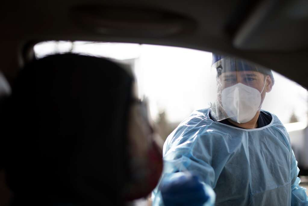 A medical technician performs a COVID-19 screening test at the Silverthorne drive-thru testing site Nov. 20. | Photo by Jason Connolly / Jason Connolly Photography