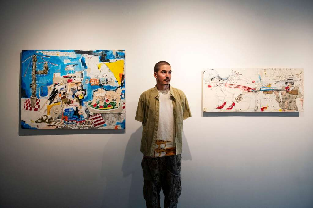 Axel Livingston, 19, stands in front of his work hanging in the Gonzo Gallery for his first show in the space in Aspen on Tuesday, April 27, 2021. (Kelsey Brunner/The Aspen Times)