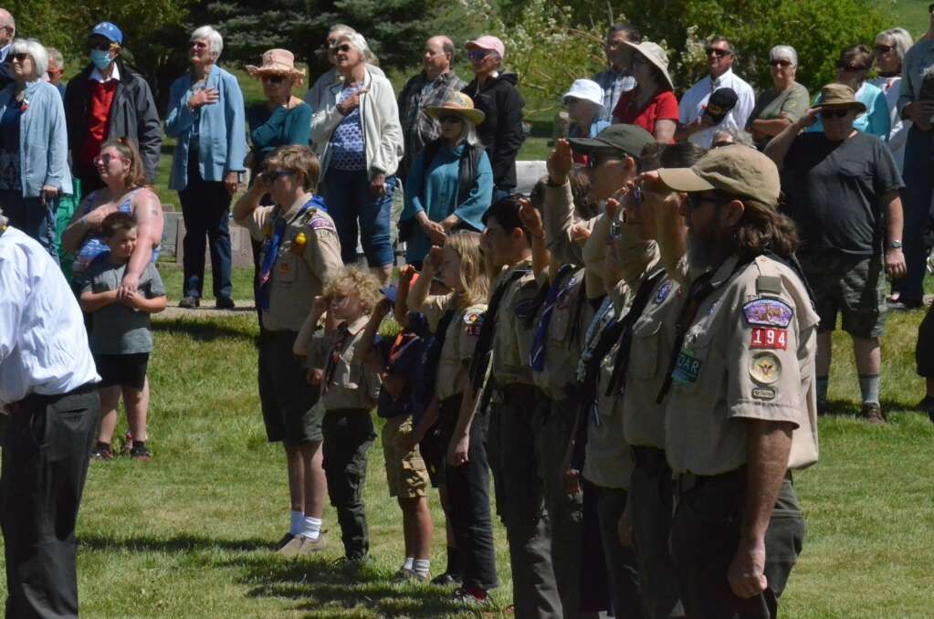 Members of the Boy Scouts and Girl Scouts participate in a Memorial Day ceremony at Steamboat Springs Cemetery. (Photo by Dylan Anderson)