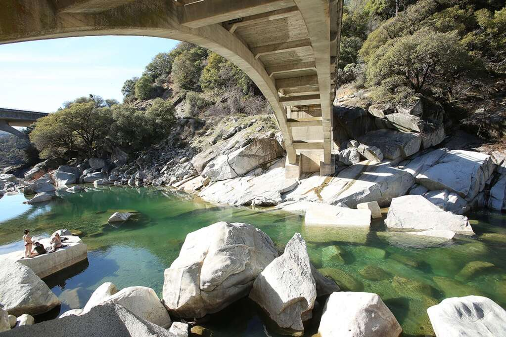 The South Yuba River gently meanders under the historic Highway 49 bridge looking a lot like a summer day in mid February in an area that usually has more water during this time of year. The Northern Sierra Nevada Precipitation index was at 58% of normal. | Photo: Elias Funez