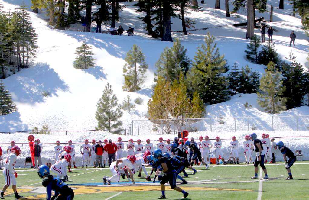 Fans watch Saturday's game from the hillside overlooking the South Tahoe field. <em id=