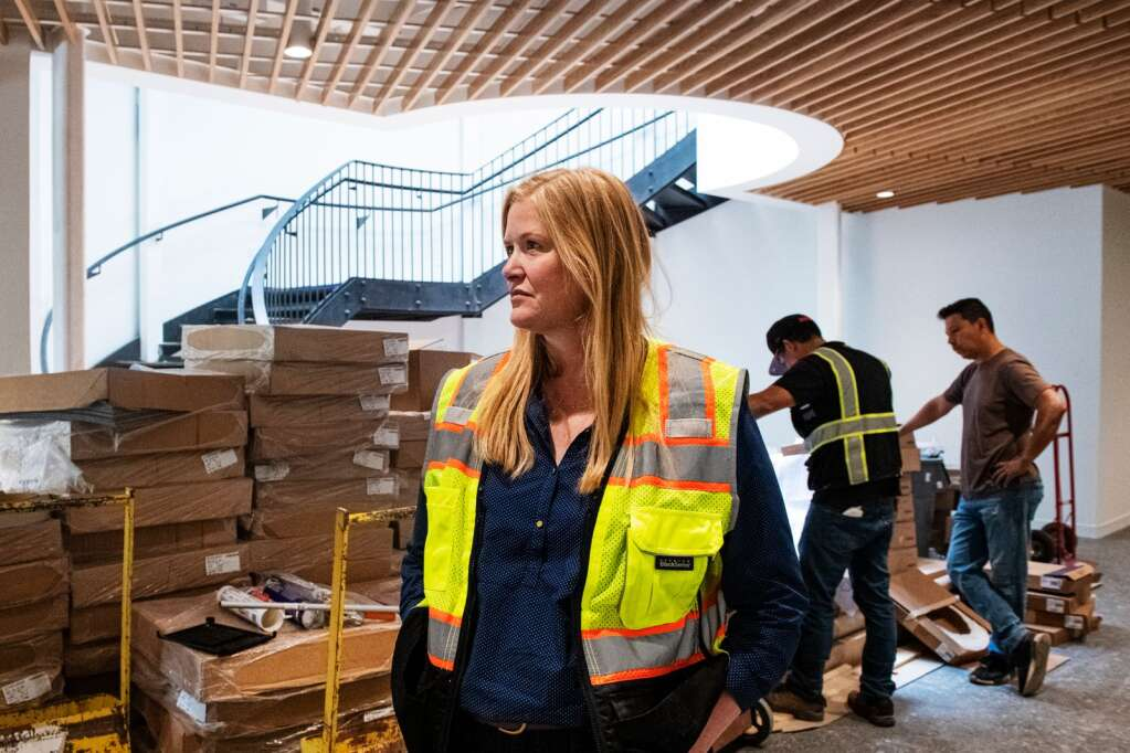 Aspen City Manager Sara Ott stands in the entrance hall of the new City Hall building as construction continues at the location on Thursday, July 15, 2021. (Kelsey Brunner/The Aspen Times)