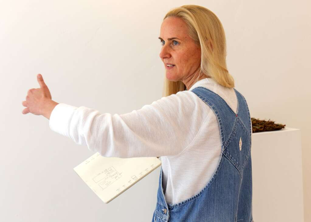 Boulder artist Heather Cherry works on setting up her exhibit on Thursday, May 27, 2021, in the Art Base's new location in downtown Basalt. Photo by Austin Colbert/The Aspen Times.
