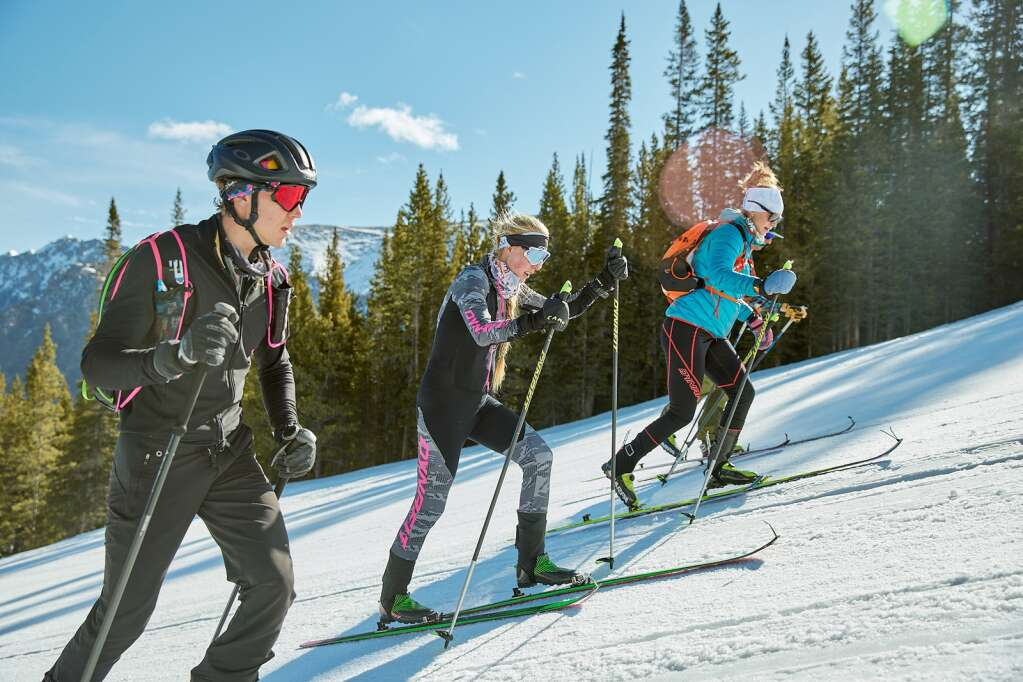 Grace Staberg, center, skis up Copper Mountain Resort with friends helping her pace during an attempt to set a world record for most vertical feet skied in 24 hours. | Photo by Andrew Maguire / Dynafit