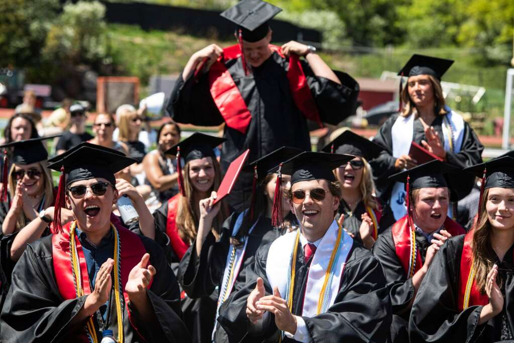 Aspen High School graduates cheer on their classmates during the commencement ceremony on Saturday, June 5, 2021. (Kelsey Brunner/The Aspen Times)