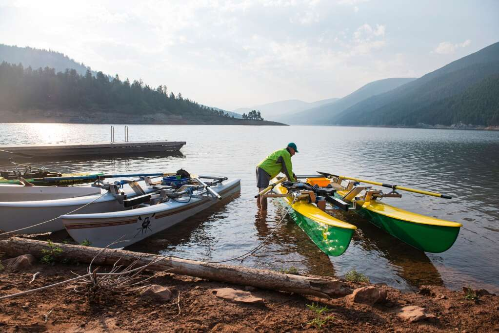 Jack Rafferty prepares one of his boats for rowing on Ruedi Reservoir at 7:30 a.m. on Tuesday, July 13, 2021. (Kelsey Brunner/The Aspen Times)