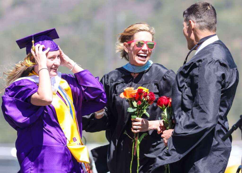 Outgoing Assistant Principal Megan Baiardo, center, and Principal Peter Mueller, right, laugh with a student during the Basalt High School graduation ceremony on Saturday, May 22, 2021, on the BHS football field. Photo by Austin Colbert/The Aspen Times.