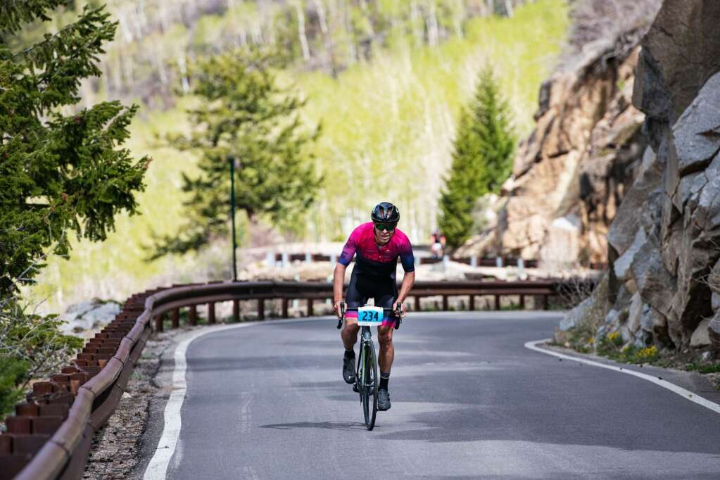 A biker pulls away from the group during the 2021 annual Ride for the Pass event starting in Aspen on Saturday, May 22, 2021. (Kelsey Brunner/The Aspen Times)