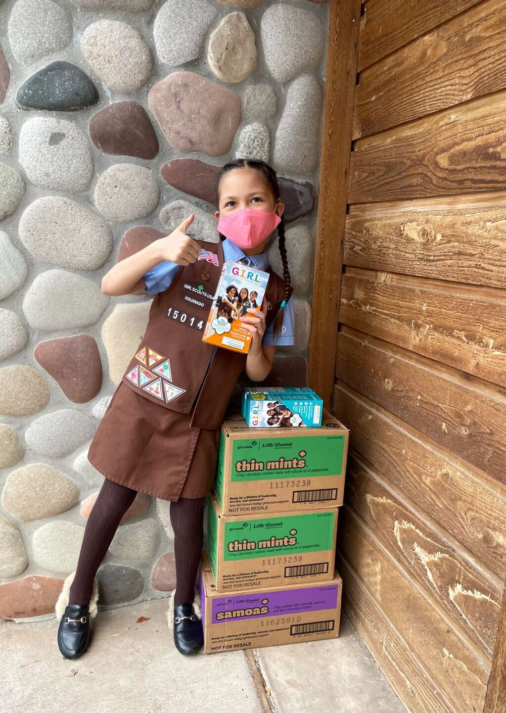Aspen Girl Scout Ava Gentry, 9, delivers boxes of Thin Mints and Samoas for a contactless cookie drop. | Heather Merritt Gentry/Courtesy image