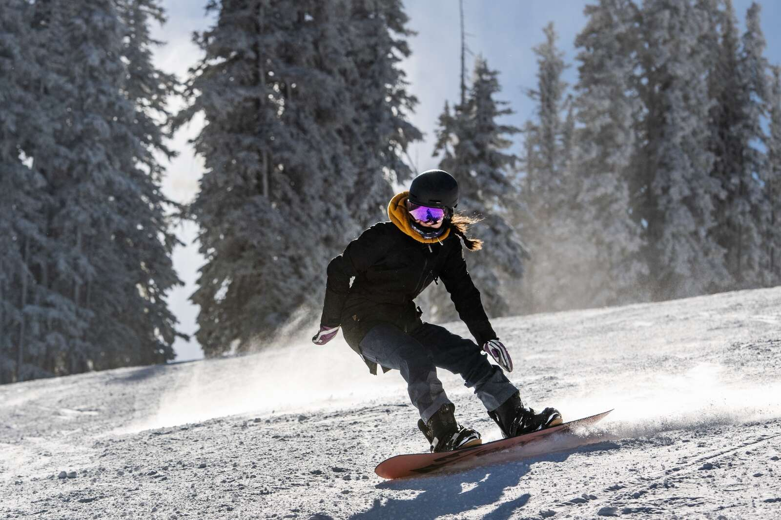A snowboarder carves on opening day at Aspen Mountain on Wednesday, Nov. 25, 2020. (Kelsey Brunner/The Aspen Times)