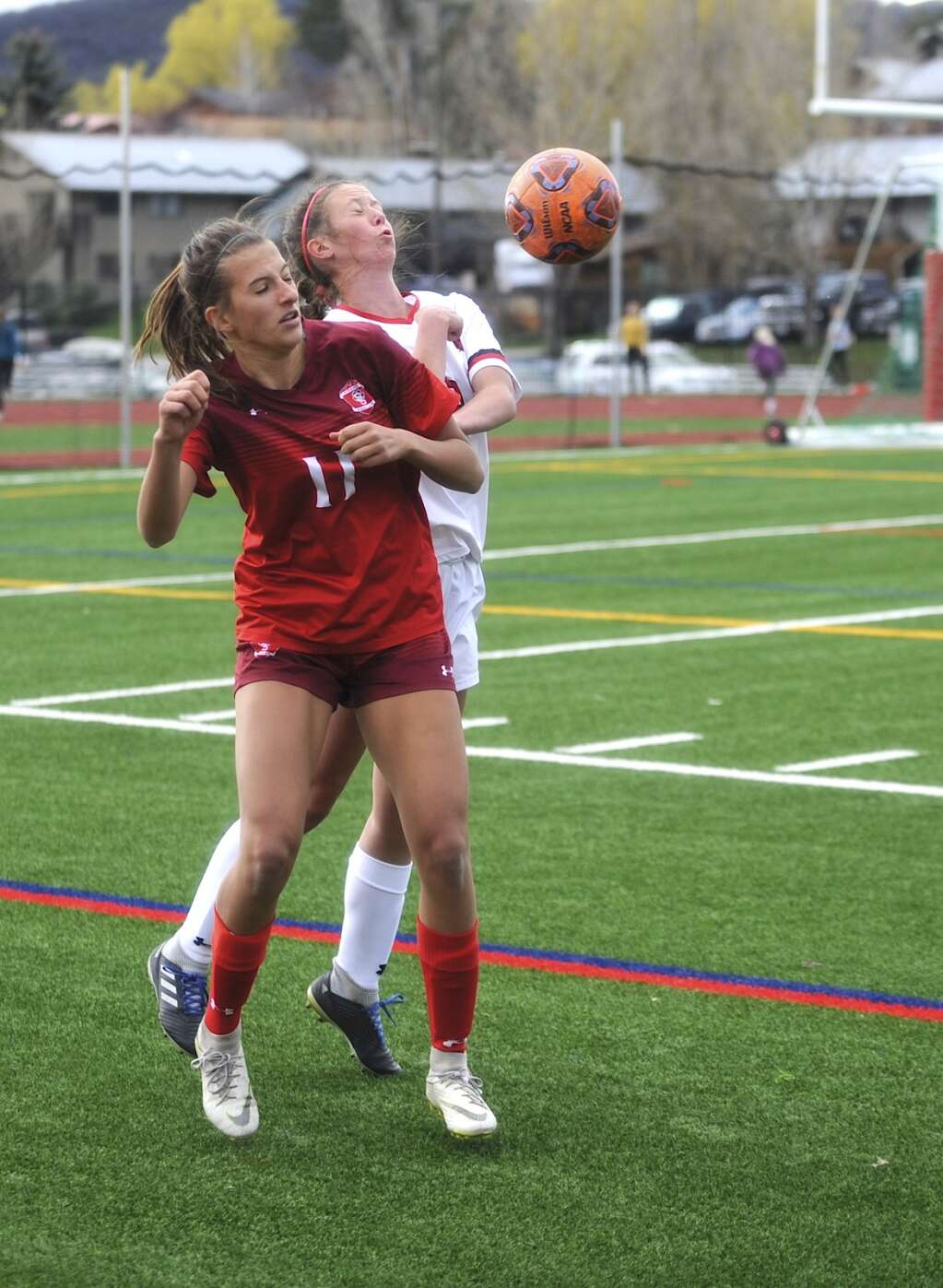 Steamboat Springs soccer player Anabel Ayad plays a throw in during a game against Glenwood Springs on Tuesday evening. (Photo by Shelby Reardon)