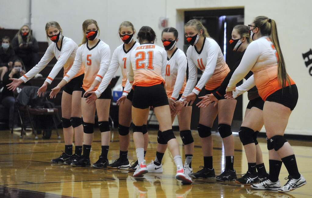 The Hayden volleyball team gets each other hyped ahead of a game at Soroco on Saturday afternoon. (Photo by Shelby Reardon)