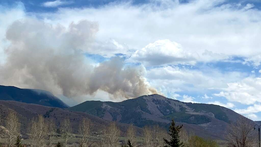 Smoke rises from the Collins Creek prescribed fire north of Aspen as seen from Aspen Village Station 64 on Friday, May 7, 2021. | David Krause/The Aspen Times