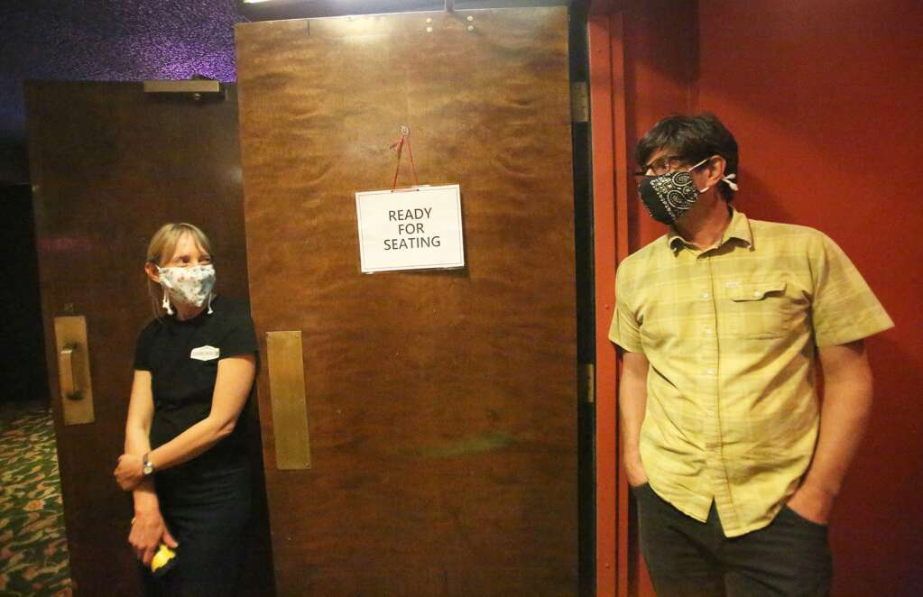 Sierra Theaters owners, husband and wife Azriel and Michael LaMarca, utilized down time due to Covid-19, to deep clean the Del Oro Theater and ready for re-opening June 28. The opening would be short lived as Covid-19 mandates would shutter the business again. | Photo: Elias Funez