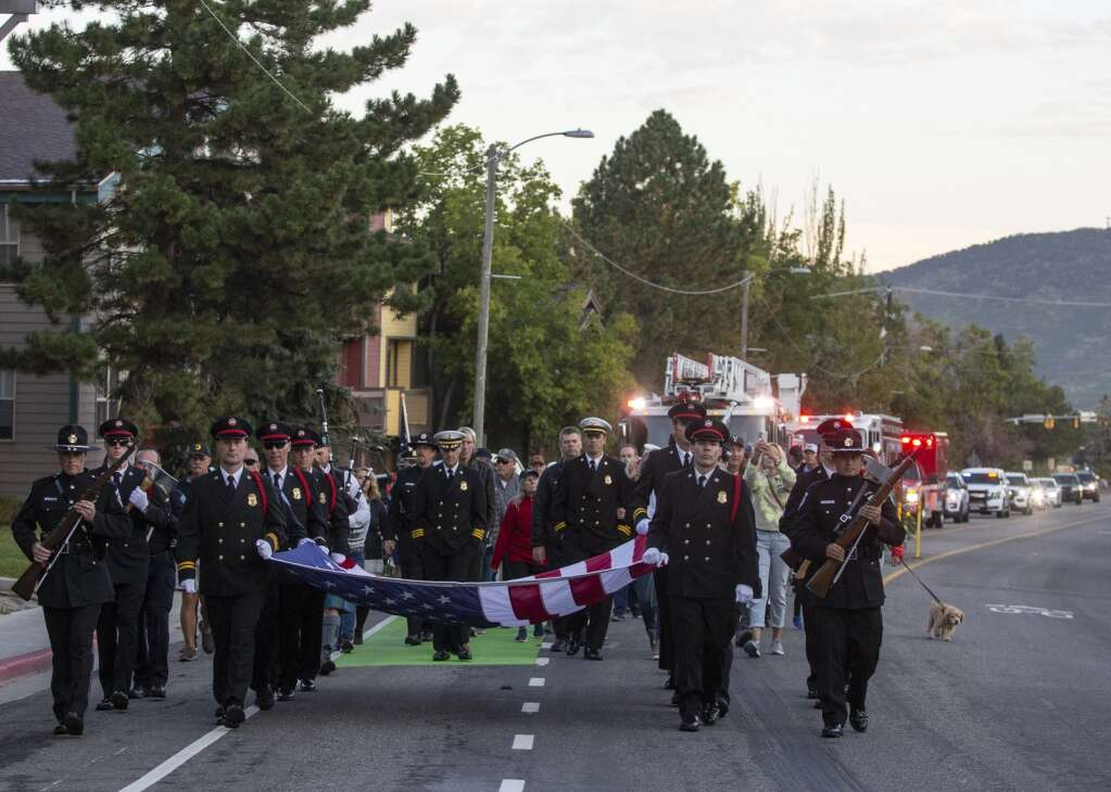 The Park City Fire District Honor Guard carries the American flag down Park Avenue Saturday morning during a procession marking the 20th anniversary of the Sept. 11 terrorist attacks. (Tanzi Propst/Park Record)