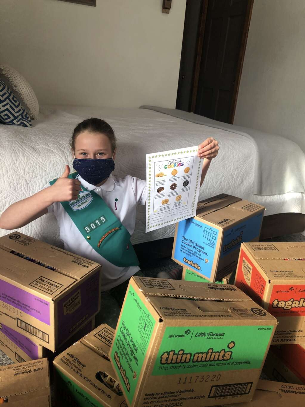 Basalt Girl Scout Stella Sgroi, 10, poses among boxes of cookies. | Tracy Sgroi/Courtesy image