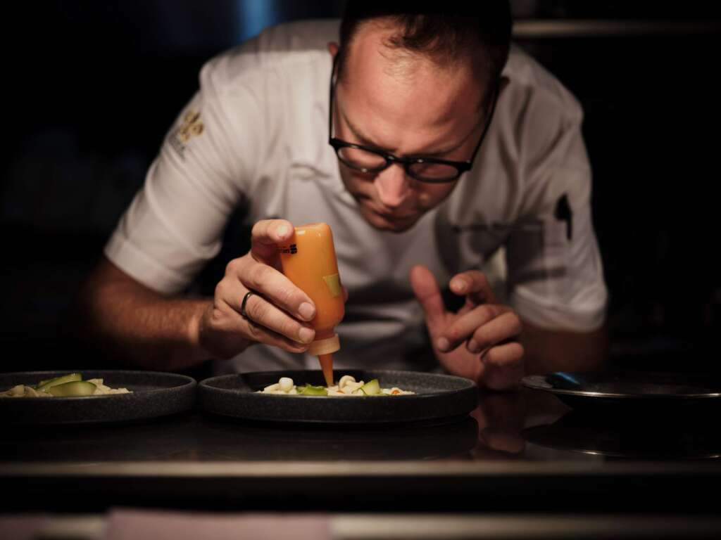Adriano Venturini, the Eden Roc Cap Cana culinary director, puts the finishing touch on a dish.