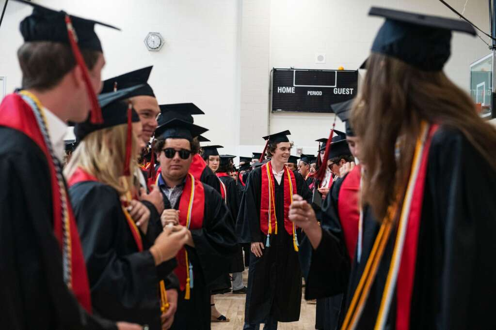 Aspen High School graduates line up in their order before processing out on the football field for the commencement ceremony on Saturday, June 5, 2021. (Kelsey Brunner/The Aspen Times)