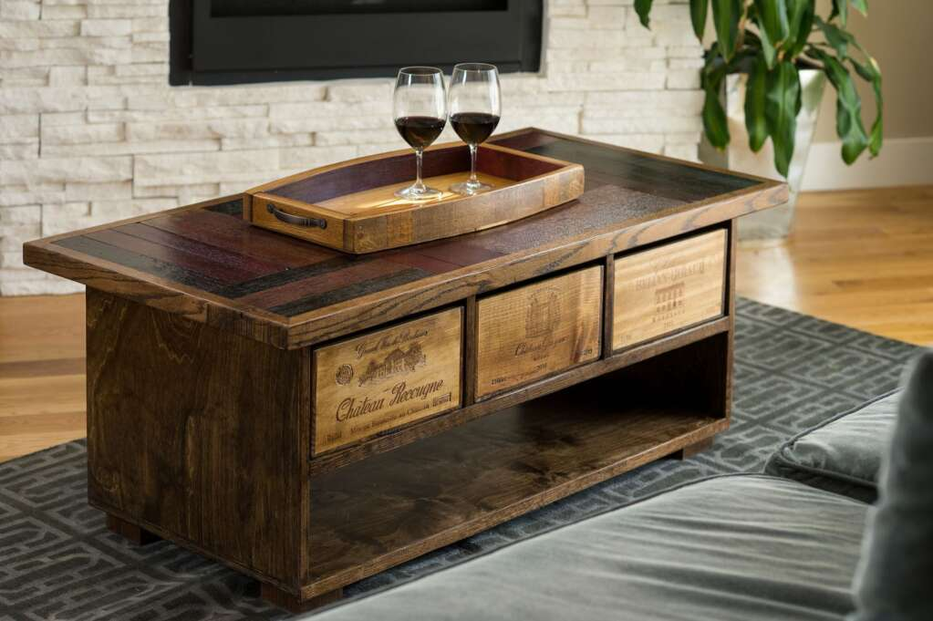 The collection of wooden creations from the artists at Alpine Wine Design includes coffee tables made from old wine barrels and boxes. | Courtesy photo