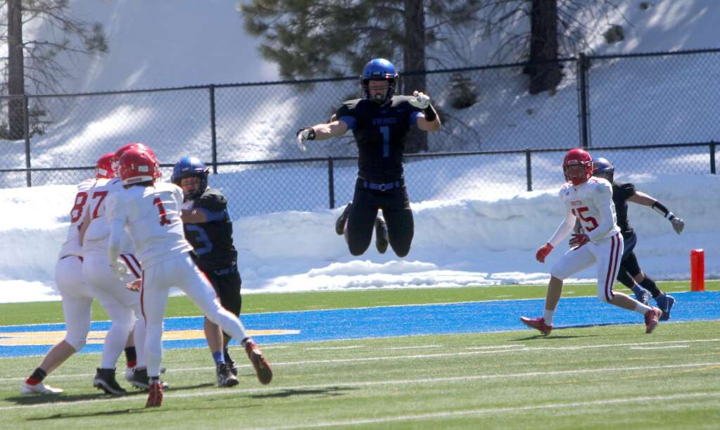 Where's the ball? South Tahoe's James Adams attempts to bat down a pass from Wooster's Christien Smith intended for Charles Seals. <em id=